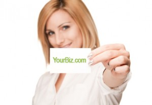 photo of woman holding up her business card